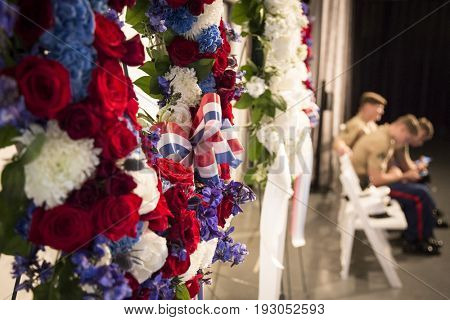 Ceremonial wreaths in honor and remembrance near U.S. Marine Corps seated at the annual Memorial Day Observance ceremony on the Intrepid Sea, Air & Space Museum, Fleet Week, NEW YORK MAY 29 2017.