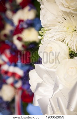 White ceremonial wreath in honor and remembrance before the annual Memorial Day Observance ceremony on the Intrepid Sea, Air & Space Museum in Manhattan during Fleet Week, NEW YORK MAY 29 2017.