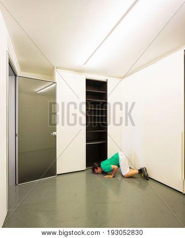 Man licks the floor