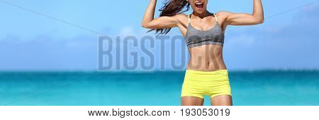 Strong fitness woman banner crop with copy space on sky. Body crop of athlete showing off slim body on beach. Weight loss success concept.