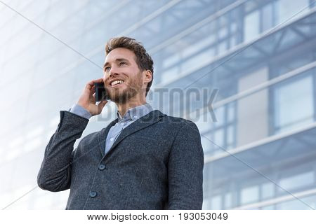 Man professional talking on phone calling business partner. Businessman real estate agent or lawyer having negotiation conversation in modern city background.