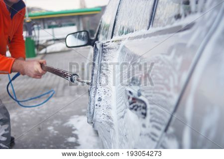 Auto Wash Closeup. Dirty Car During Washing Process On Open Air