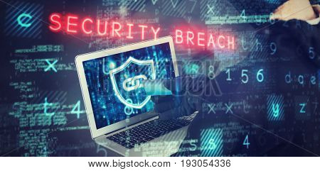 Mid section of female hacker using laptop and credit card against grey tile design