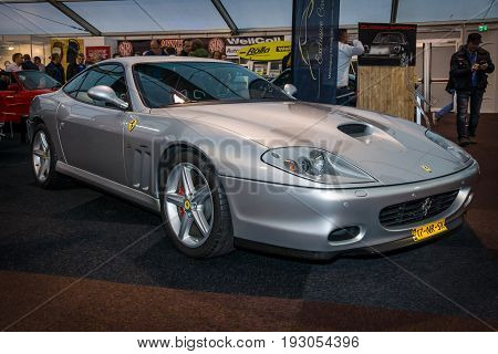 MAASTRICHT NETHERLANDS - JANUARY 15 2016: Grand tourer Ferrari 575M Maranello 2003. The designer of the car body Lorenzo Ramaciotti at Pininfarina. Intern. Exhibition InterClassics & Topmobiel 2016
