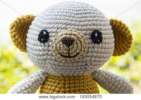 Teddy bear with plank wood board background