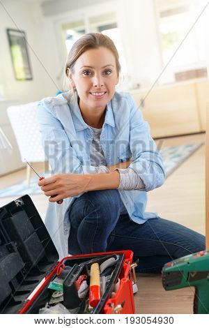 Portrait of woman doing DIY work at home