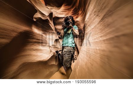 A photographer in the Lower Antelope Canyon (Arizona)