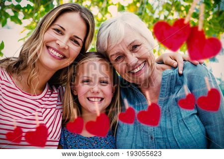 Hearts on line against portrait of happy family with granny