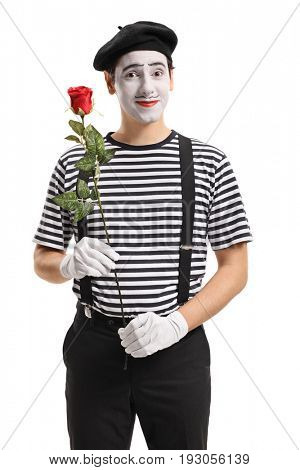 Mime holding a red rose and looking at the camera isolated on white background