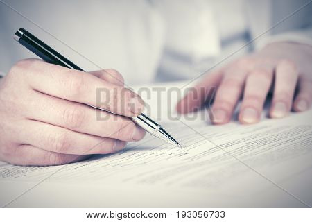 Business woman signing contract at office
