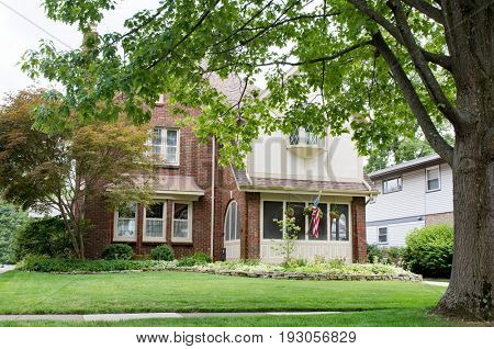 Red Brick House Surrounded by Large Oak Tree