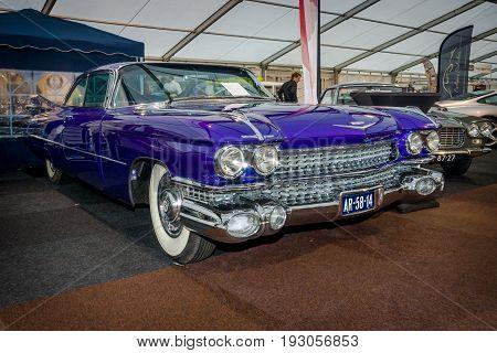 MAASTRICHT NETHERLANDS - JANUARY 15 2016: Full-size luxury car Cadillac Coupe de Ville 1959. International Exhibition InterClassics & Topmobiel 2016