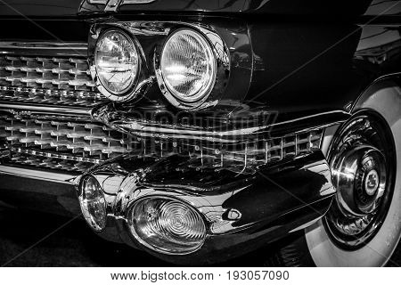 MAASTRICHT NETHERLANDS - JANUARY 15 2016: Fragment of full-size luxury car Cadillac Coupe de Ville 1959. Black and white. International Exhibition InterClassics & Topmobiel 2016