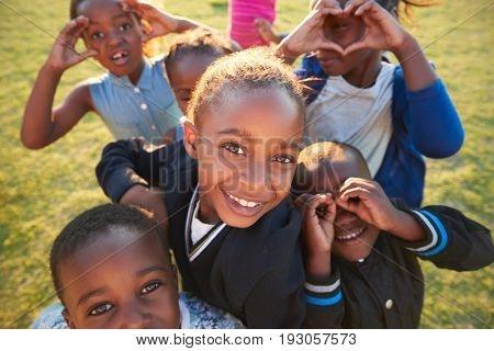 Elementary school kids having fun outdoors, high angle