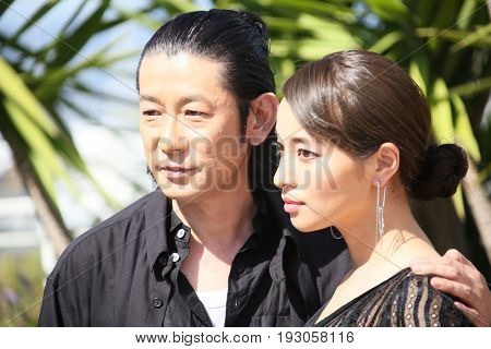 Nagase Masatoshi, Ayame Misaki attend the 'Hikari (Radiance)' photocall during the 70th annual Cannes Film Festival at Palais des Festivals on May 23, 2017 in Cannes, France.