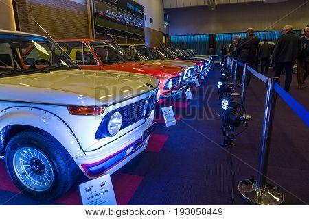 MAASTRICHT NETHERLANDS - JANUARY 15 2016: Row of different models of BMW cars. International Exhibition InterClassics & Topmobiel 2016