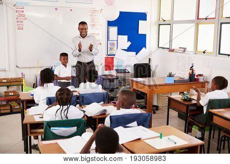Teacher taking a lesson of elementary school kids
