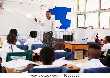 Teacher using whiteboard during a lesson at an elementary school
