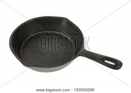 Cast iron black frying pan isolated on white background, side view