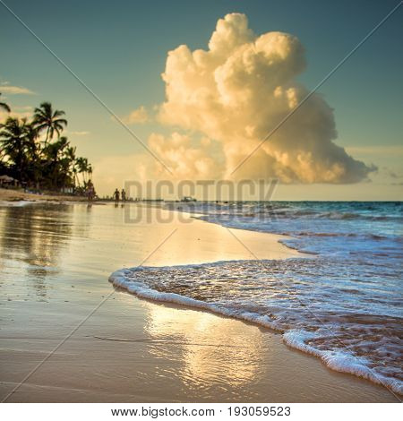 Beach sunset with clouds in distance