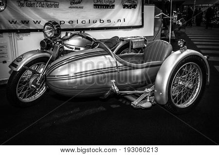 MAASTRICHT NETHERLANDS - JANUARY 15 2016: Motorcycle with sidecar Opel Elite 500 1928. Black and white. International Exhibition InterClassics & Topmobiel 2016