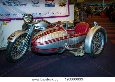 MAASTRICHT NETHERLANDS - JANUARY 15 2016: Motorcycle with sidecar Opel Elite 500 1928. International Exhibition InterClassics & Topmobiel 2016