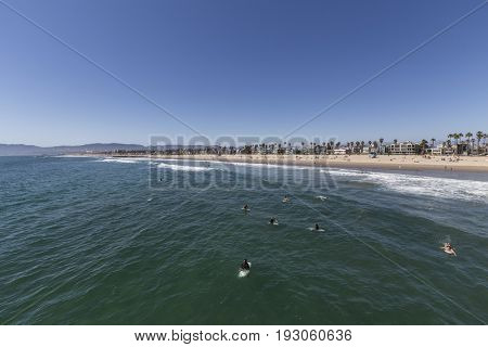 Los Angeles, California, USA - June 26, 2017:  Surfers waiting for waves at Venice Beach.