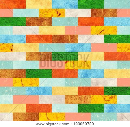 Background with paper patterns of different colors - yellow, brown, blue, green, red and beige. Endless texture can be used for wallpaper, pattern fills, web page background, surface textures