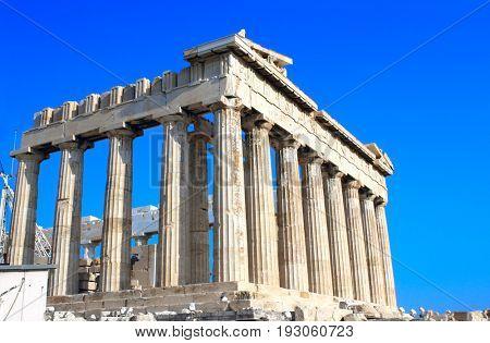 Parthenon on the Acropolis in Athens, Greece. On blue sky background