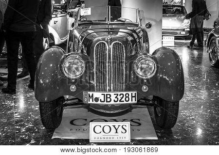 MAASTRICHT NETHERLANDS - JANUARY 15 2016: Vintage car BMW 328 Roadster 1936. Black and white. International Exhibition InterClassics & Topmobiel 2016