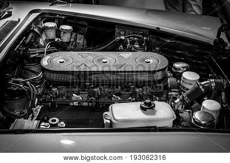 MAASTRICHT NETHERLANDS - JANUARY 15 2016: Engine of a sports car Ferrari 330 GT 2+2 Series 1 1965. Black and white. International Exhibition InterClassics & Topmobiel 2016