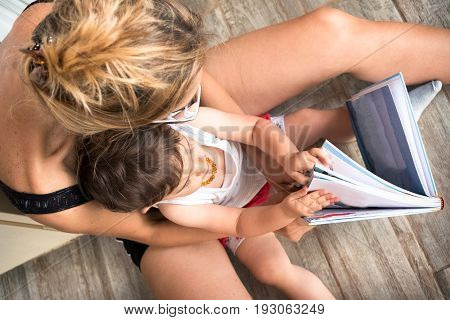 mom read stories to the child browsing book