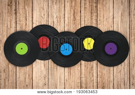 3d rendering colorful vinyl record on wooden background