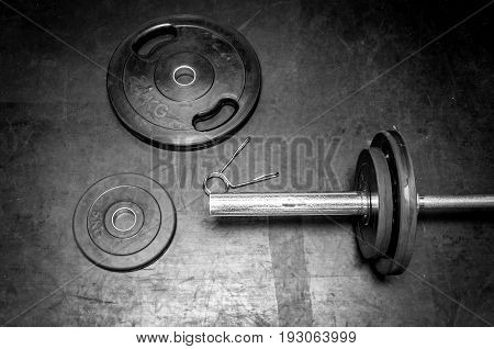 Fitness exercise equipment weights plates. Black and white. Barbell.