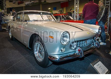 MAASTRICHT NETHERLANDS - JANUARY 15 2016: Sports car Ferrari 250 GT/E 1962. International Exhibition InterClassics & Topmobiel 2016