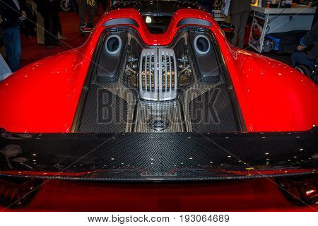 MAASTRICHT NETHERLANDS - JANUARY 15 2016: The engine compartment of a supercar Porsche 918 Spyder. International Exhibition InterClassics & Topmobiel 2016