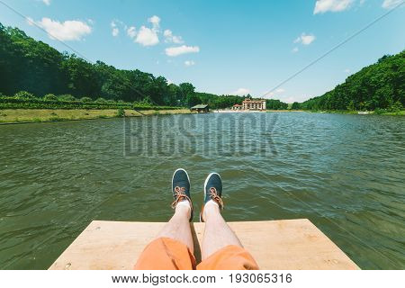 first person view man on the pair lookin on a lake in sunny day
