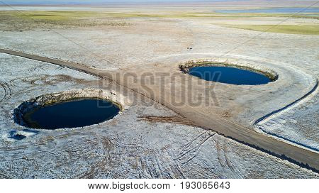 Aerial view of Ojos del Salar or Eyes of the Salt Pan at the Atacama desert, Chile