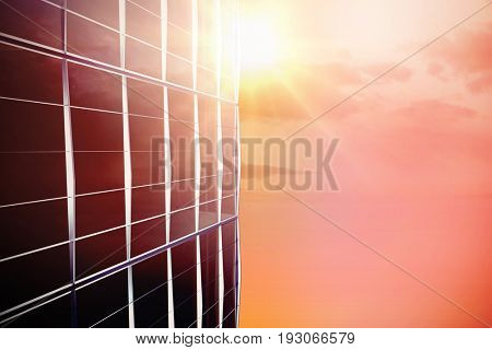 Directly below shot of modern building against low angle view of cloudscape in sky