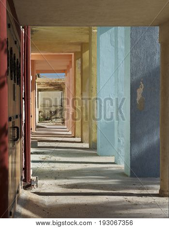 Colorful Corridor with columns and shadows on sunny day. Colorful columns. Abstract architectural photo, columns, diagonal, street photography. Architectural details