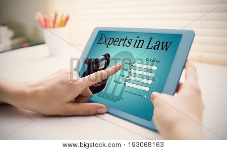 Graphic interface of lawyer contact form  against cropped image of person using on digital tablet