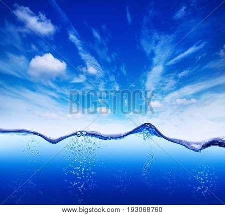 water background against a blue sky with oxygen bubbles