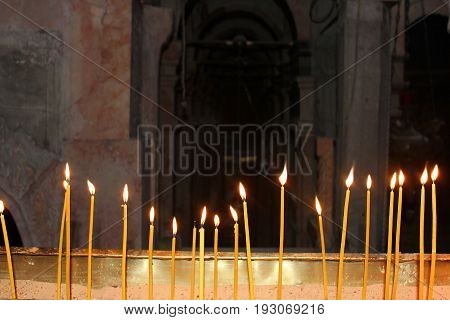 burning memorial candles in the christian temple