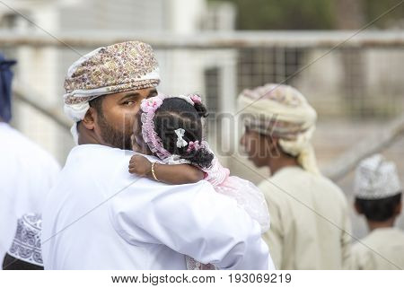 Little Omani Girl Isleeping On A Shoulder Of Her Daddy