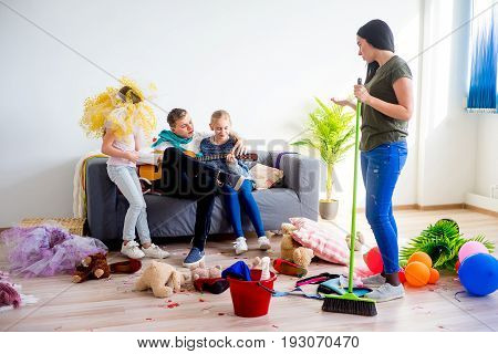 Mother yelling on her romping kids who created a mess