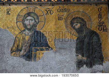 Save Download Preview Istanbul, Turkey - June 6, 2014: Christian mosaic icon of Jesus Christ and Saint John the Baptist in Cathedral mosque Hagia Sofia in Istanbul