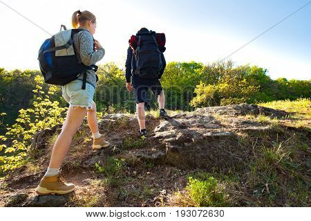 Active young Couple hiking in the forest during summer. Travel hiking backpacking tourism and people concept