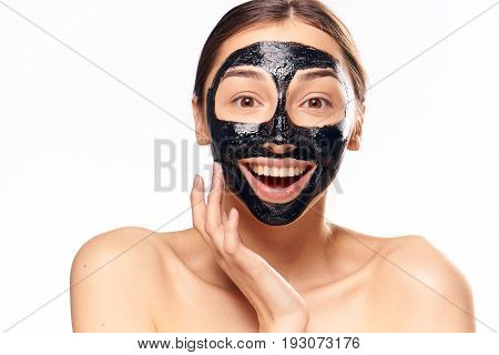 Black coal cosmetic face mask, woman on white isolated background.