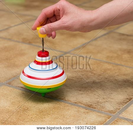 Old fashioned revolvable whirligig hand. Children s toy.