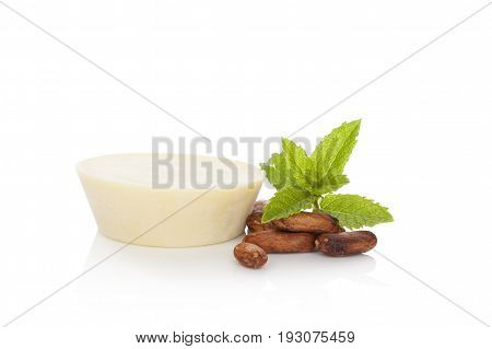 Natural healthy massage soap with cocoa seeds and mint isolated on white background. Natural organic cosmetics.